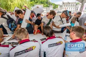 Handtekeningen sessie van de BMW Sports Trophy Team Marc VDS coureurs tijdens de parade van de Total 24 Hours of Spa in het centrum van Spa