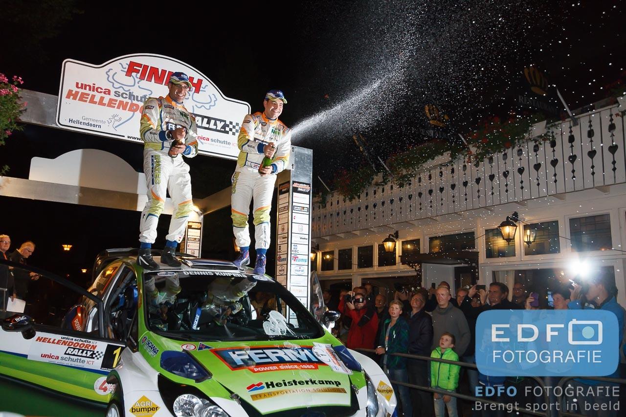 Dennis Kuipers en Robin Buysmans winnen de Unica Schutte en ICT Hellendoorn Rally 2015 en mogen met de champagne spuiten op de dorpsstraat in Hellendoorn voor Restaurant De Kroon