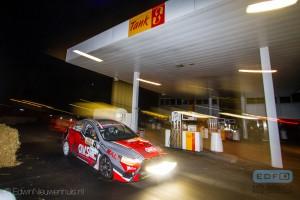 Claude Bal en Brjorn Deforche in een Mitsubishi Lancer EVO 10 op weg naar de tweede plaats in de Tank S Rally